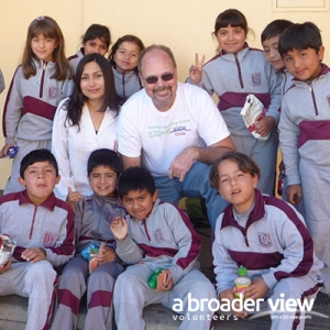 A Broader View volunteers with children receiving assistance