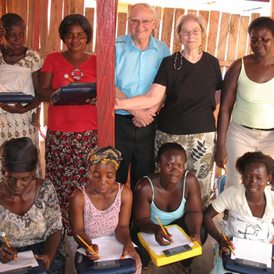 Global Mamas volunteers with women receiving employment training and assistance