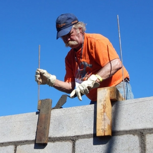 Volunteer working on a house for the Fuller Center